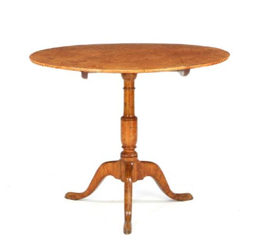 A Karl Johan birchwood and birchroot tilt-top table