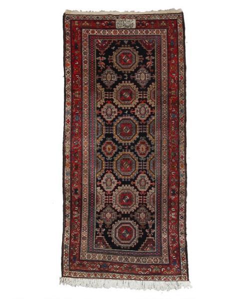 A signed North West Persian rug, design of Salor güls