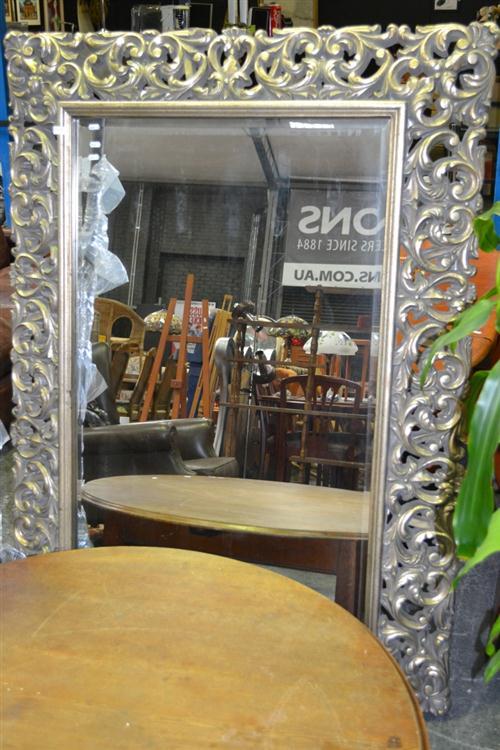 Heavily Ornate Framed Bevelled Edge Mirror