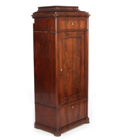 A Danish late Empire mahogany pedestal cupboard