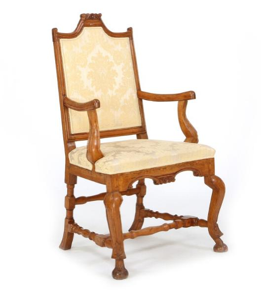 A baroque Norwegian birchwood armchair.