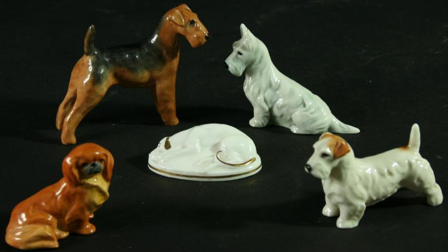 A COLLECTION OF FOUR ROYAL WORCESTER DOGS