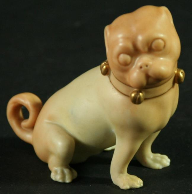 A ROYAL WORCESTER BLUSH IVORY FIGURE OF A PUG DOG