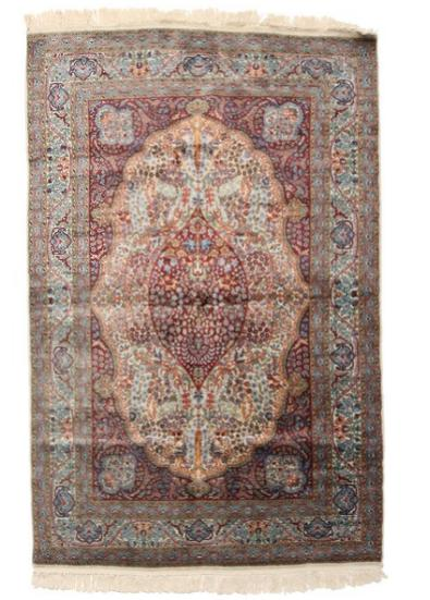 A 20th century Pakistani rug, Qum medaillon design with ornaments