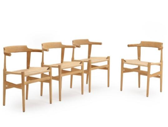 A set of four chairs with oak frame