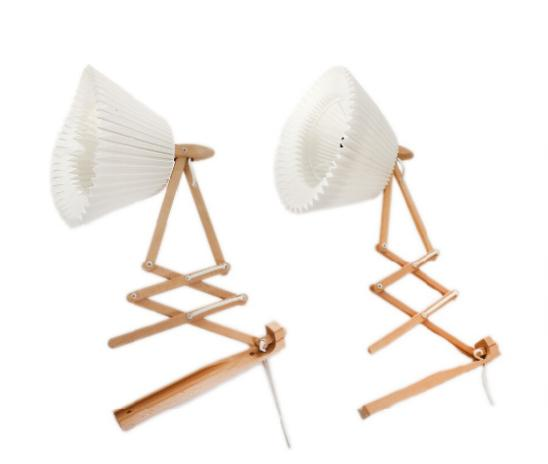 A pair of foldable beech lamps, one shade of pleated acrylic included