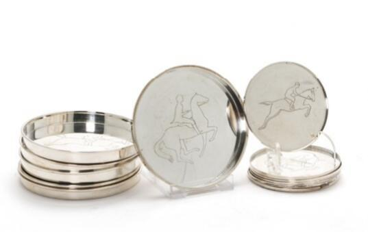 A sterling silver bottle and glass coasters. The inside with various motifs of horsemen