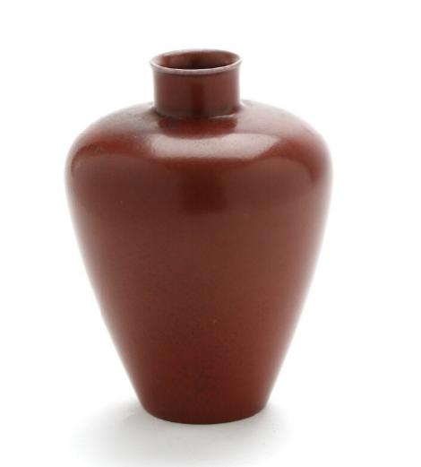 A stoneware vase decorated with oxblood glaze. Stamped monogram, 20377, 513
