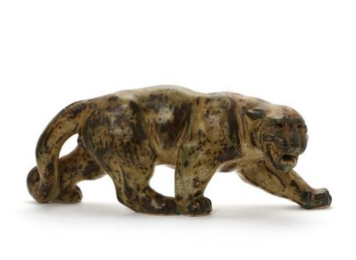 Stoneware figure modelled in the shape of a panther, decorated with sung glaze