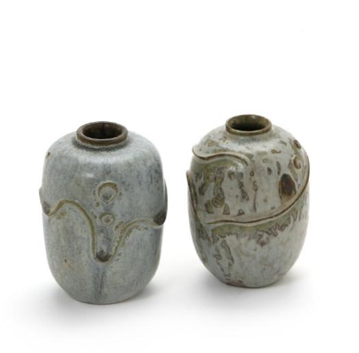 Two small stoneware vases modeled with ornaments in relief