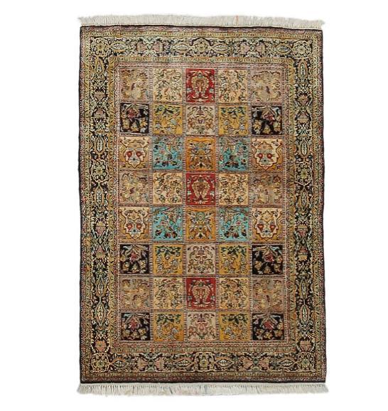 A Qum full silk rug, Persia. Garden of paradise design