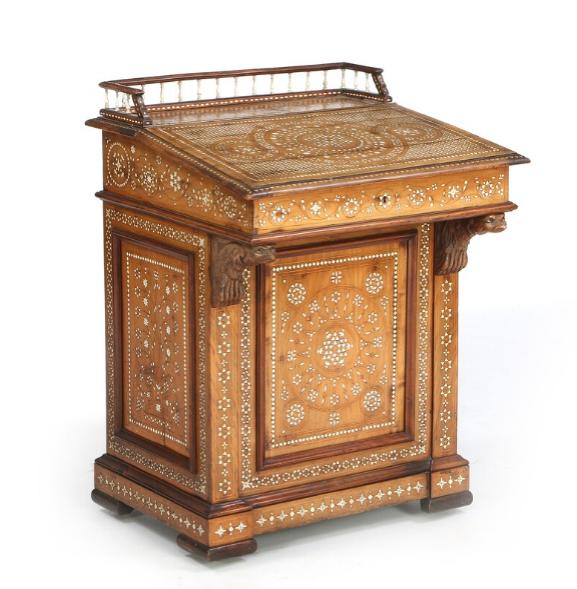 A small Italian walnut desk with bone inlays