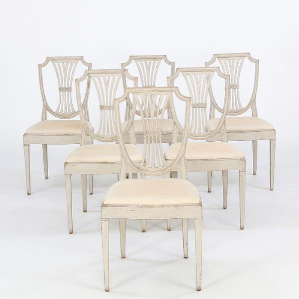 A set of six painted Swedish side chairs with shield shaped backs