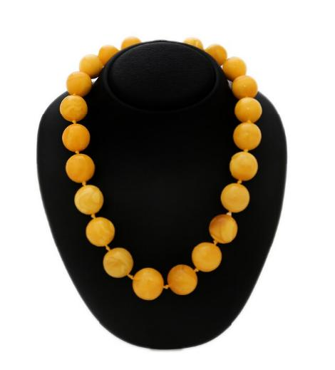 An amber necklace of presumably pressed amber beads