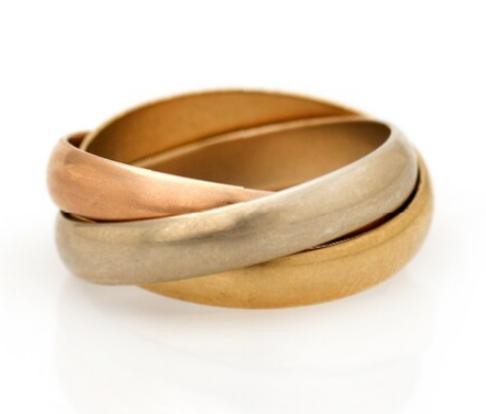 A Trinity ring of 14k gold, white and rose gold. Size 49
