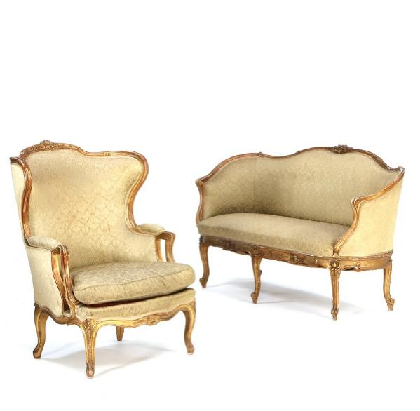 A small rococo style suite of giltwood furniture, consisting of a bergere and a sofa