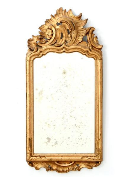 A small Danish rococo giltwood mirror.