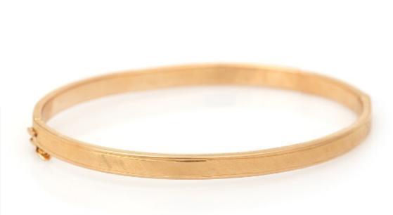 A bangle of 14k gold. Diam. 6.4 cm. Weight app. 8 g.