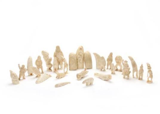 Collection of various carved sperm whale tusk tupilaks
