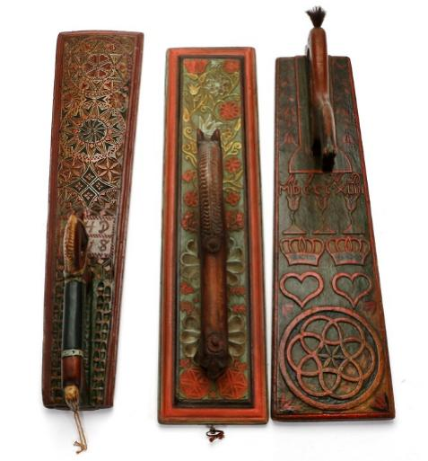 Three carved and painted wood laundry boards