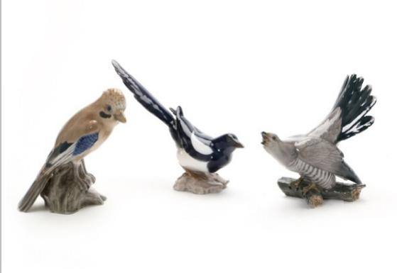 Three porcelain figurines depicting various birds. Bing & Grøndahl