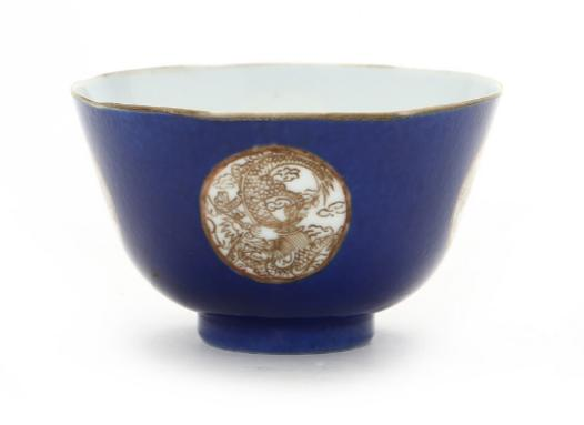 A Chinese porcelain bowl decorated in gold on blue sgrafitto ground