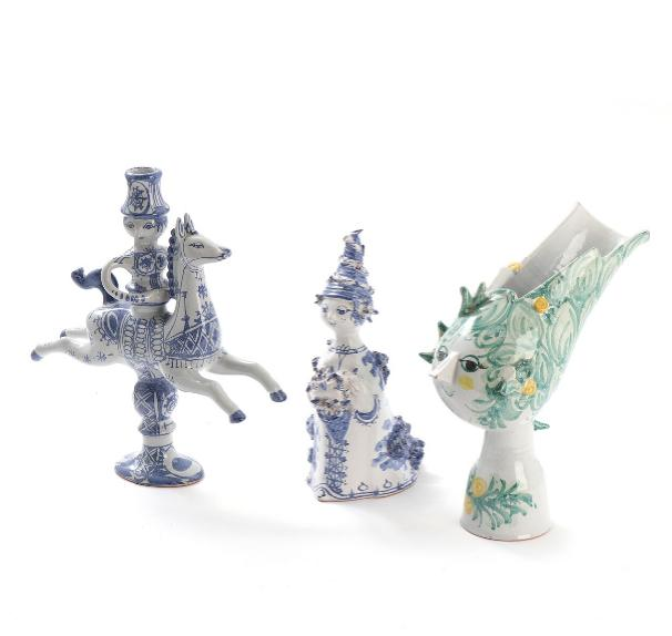 Three pieces of earthenware comprising centrepiece, candlestick and female figure