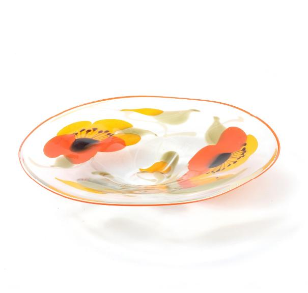 A clear glass dish decorated with flowers in yellow, orange and green glass