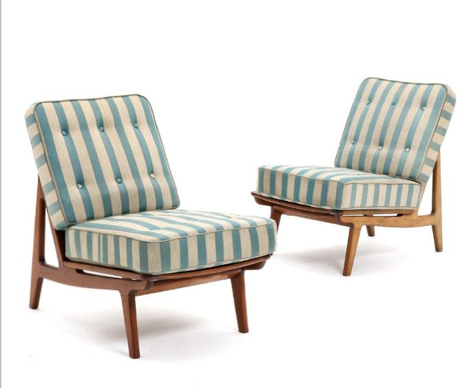 A pair of easy chairs beech with loose epeda cushions