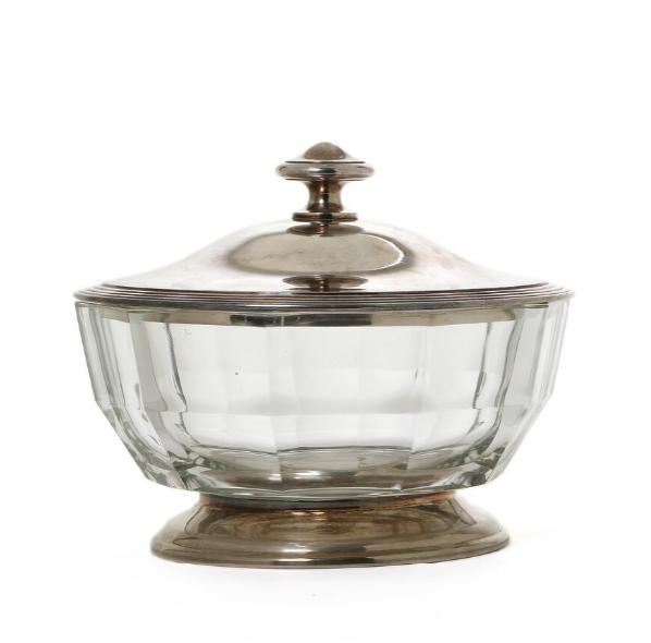 Glass bowl with bottom and lid of plated silver.