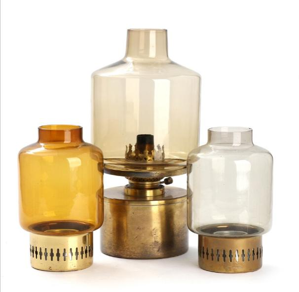 A paraffin table lamp and a pair of minor lamps for tealights.
