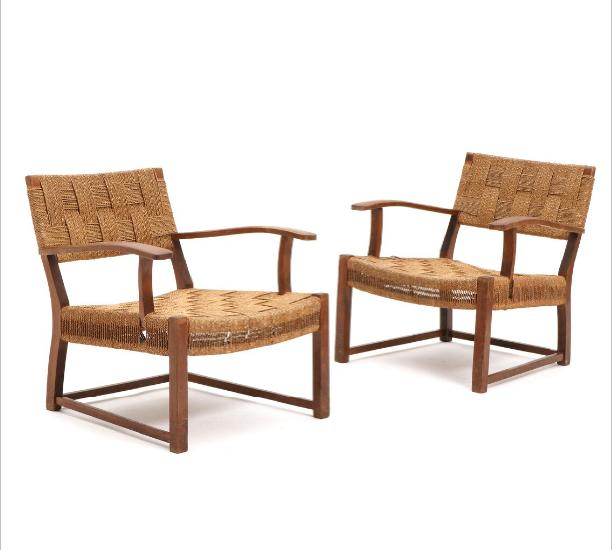 A pair of stained beech arm chairs