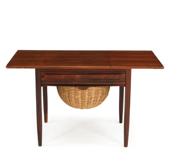 Sewing table of rosewood with sliding top, flip down leaf, drawer and yarn basket