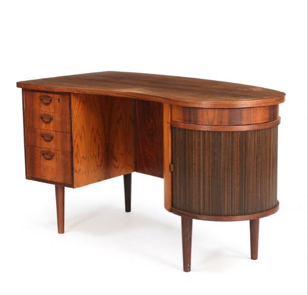 Freestanding teak desk, mounted on round tapering legs