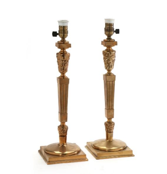 A pair of large table lamps of polished brass