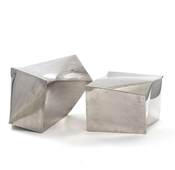 Two modernistic steel sculptures