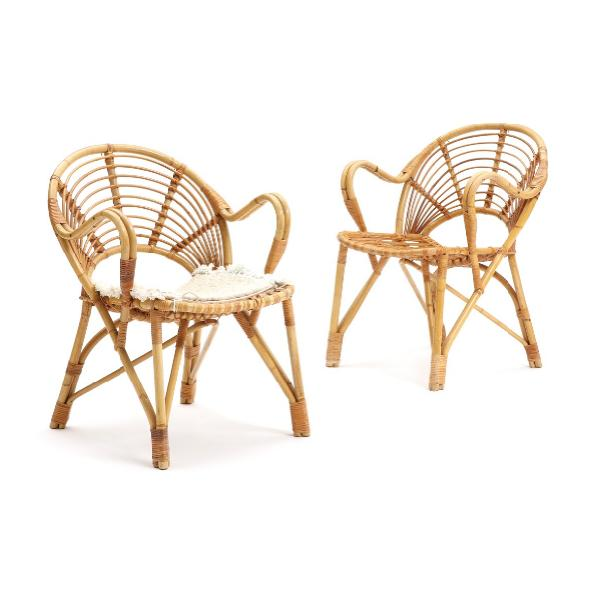 A pair of moulded bamboo chairs, gimped with cane, one chair with loose cushion