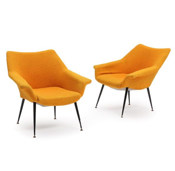 A pair of easy chairs upholstered with yellow fabric