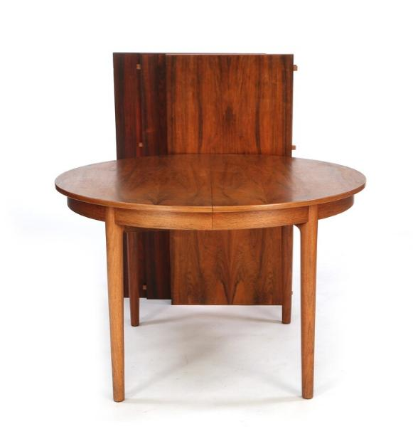 Circular dining table with three extra leaves of rosewood