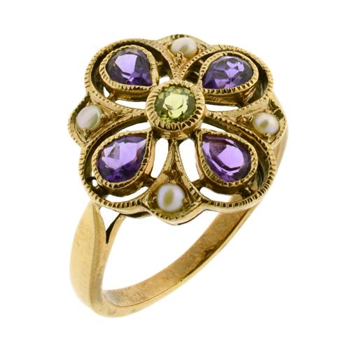 A SUFFRAGETTE THEMED 9CT GOLD RING