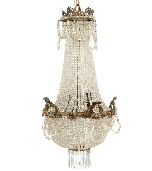 A crystal chandelier with bronze frame