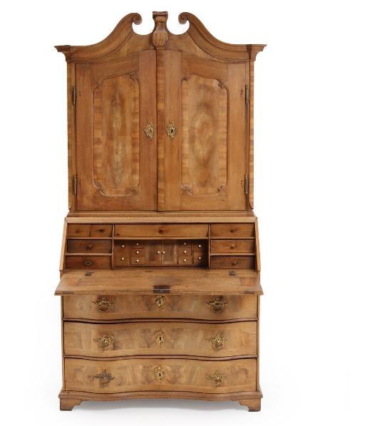 A German 18th century Baroque oak and walnut bureau bookcase