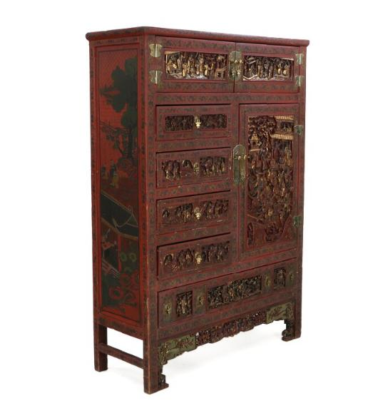 A red-lacquered and partially gilt Chinese cupboard