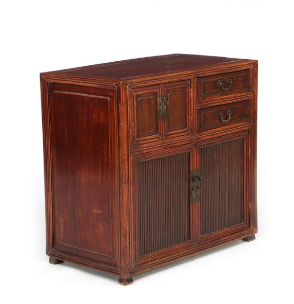 A small Chinese elmwood cabinet