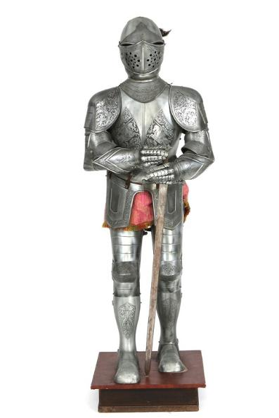 An iron armour on a wooden base. Including sword