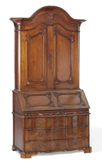 A Norwegian Rococo oak bureau cabinet with arched profiled top