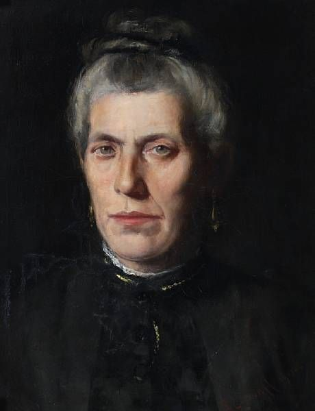 Portrait of a lady, bust length, her grey hair tied in a bun, wearing a black dress