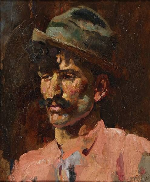 Portrait of a man, bust length, wearing a trilby and pink shirt