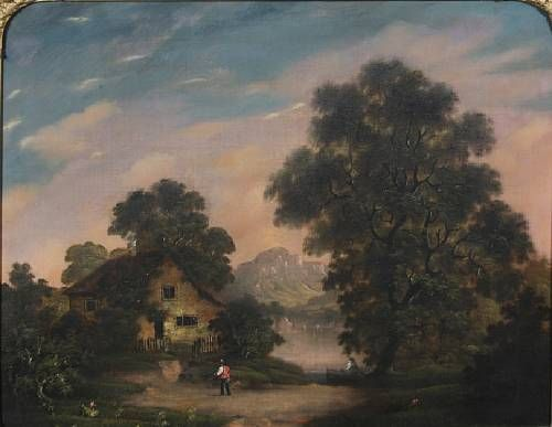 Cottage by a wooded lake