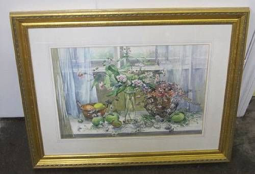 Fruit and flowers in a window